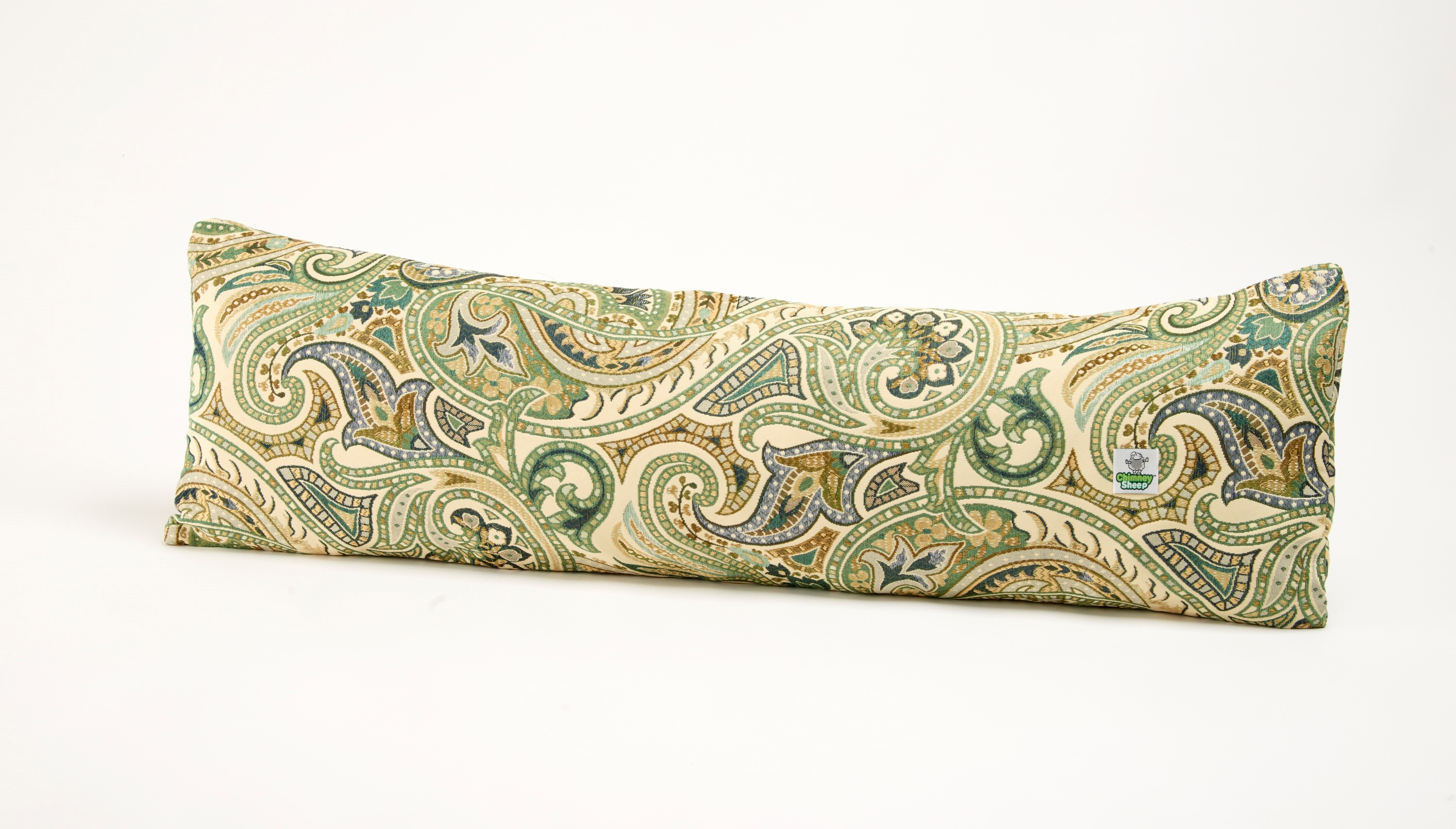 A large door draught excluder filled with Herdwick wool is a robust draft stopper. The cover comprises a paisley swirl of confident greens and blues